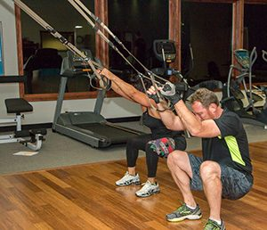 Two people using fitness equipment at Phoenix Athletica in Pocono Summit, PA